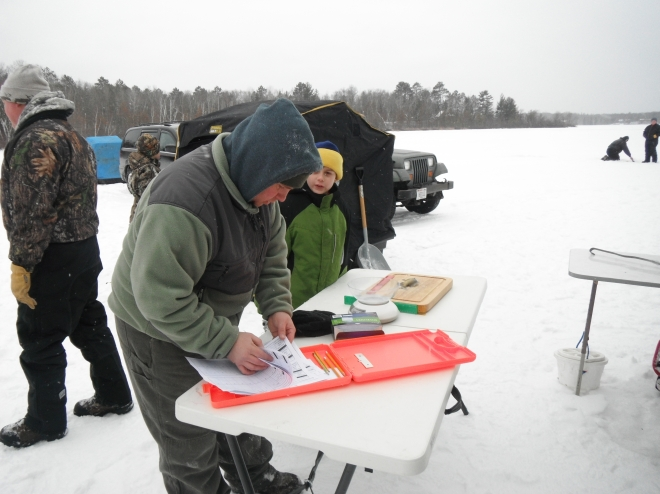 Measuring fish and taking scale samples